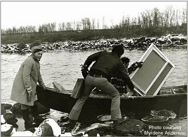 Bier Ante Ris'ten (left); Ronald Davis (center) with paint box and portable easel; and Stanley Roseman (right) with his canvases as they prepare to cross a river in a rowboat in Lappland, 1976. Photo courtesy of Myrdene Anderson.
