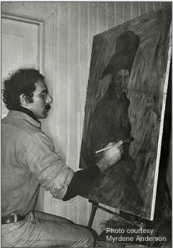 Stanley Roseman painting a portrait of Mát'te, who kindly sat for the artist in the reindeer herder's winter dwelling in the hamlet of Soaht'tofiel'bmá, Kautokeino Township, 1976. Photo courtesy of Myrdene Anderson