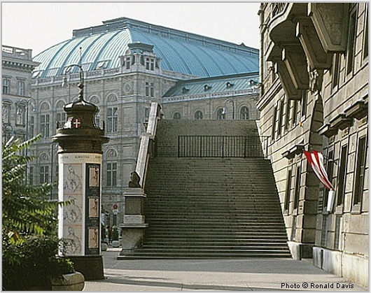 "Entrance to the Albertina (right), Vienna. Column with posters announcing the museum's exhibitions ""Raphael in der Albertina,"" and ""Stanley Roseman - Zeichnungen aus Klostern,"" 1983. Photo © Ronald Davis"
