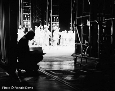 "Stanley Roseman drawing from the wings of the stage of the Paris Opéra at a performance of ""The Rite of Spring,"" 1994. © Photo Ronald Davis"